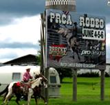 pcra-rodeo-sign-cowboy-riding-horse